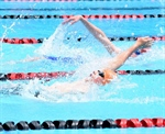 SWIMMING: Opening race kicks off competition