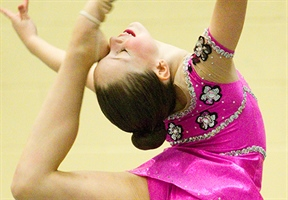 Former Olympian judging rhythmic gymnastics at Winter Games